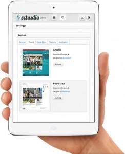 Schudio CMS settings page on ipad mini held in a hand